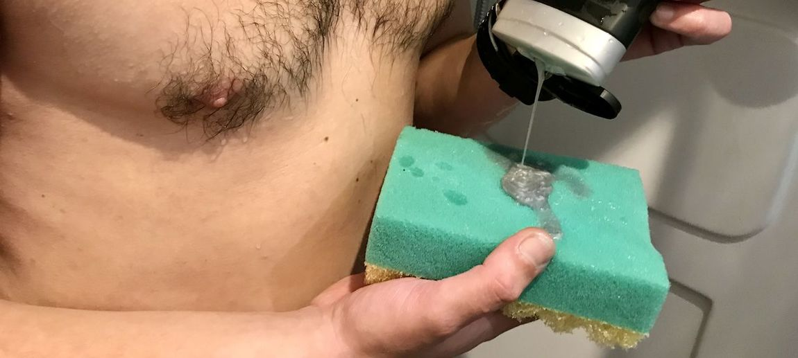 Close-up of man working in bathroom