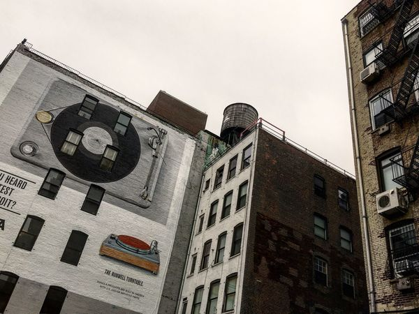 Roof Building Exterior Architecture Built Structure Low Angle View Window City Streetphotography Streetart Street Art Streetart/graffiti StreetArtEverywhere Street Art/Graffiti Street Artist Wall Wall - Building Feature Vintage Vinil Publicity Advertising Wall Art Water Castle Outdoors New York City New York Art Is Everywhere #urbanana: The Urban Playground