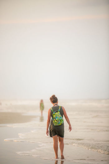 High humidity Backpack Beach Carefree Clear Sky Copy Space Enjoyment Escapism Getting Away From It All Humidity Leisure Activity Ocean Outdoors Remote Residue Sand Scenics Sea Solitude Stroll Tranquil Scene Tranquility Vacations Walking Weekend Activities Young Female