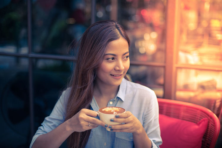 Beautiful Woman Close-up Drink Focus On Foreground Food And Drink Freshness Front View Happiness Holding Night One Person One Young Woman Only Outdoors People Portrait Real People Smiling Young Adult Young Women