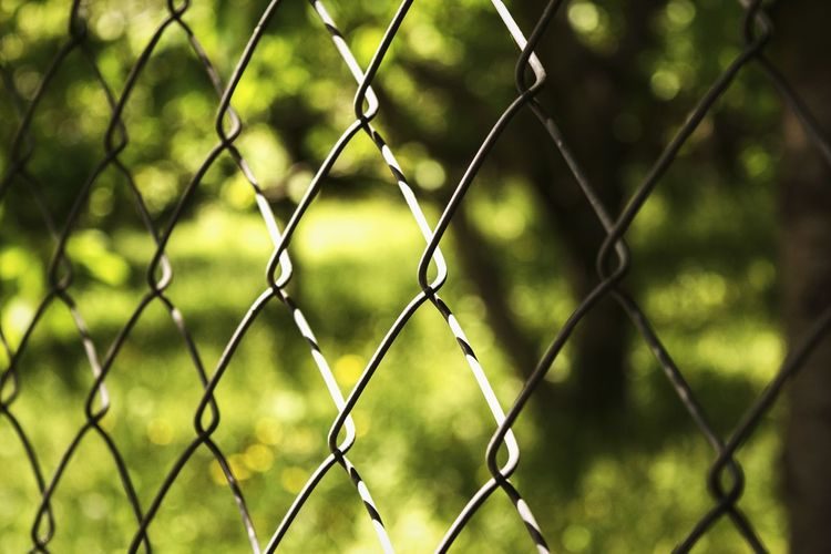 Chainlink fence seen through chainlink fence
