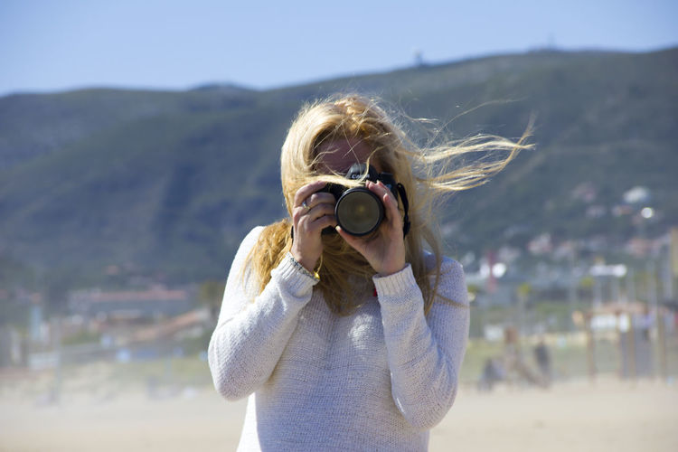 People snapping photos Beach Photography Beauty In Nature Canon Casual Clothing Day Focus On Foreground Headshot Leisure Activity Lifestyles Make Picture Making Photos Nature Outdoors People Photography Photographer Photoshoot Portrait Sea Seaside Sky Snapping Pics Spring