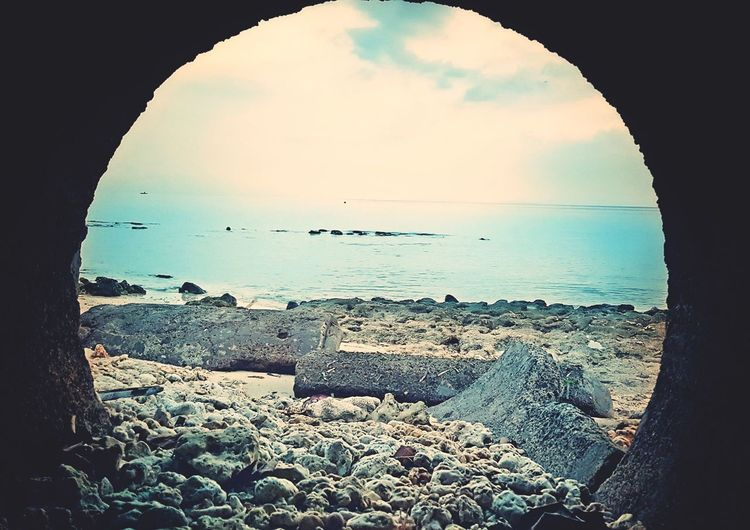 Sea Beach Horizon Over Water No People Water Sky Outdoors Bird Nature Day Animal Themes Beauty In Nature Hole Drainage Drainpipe Stones & Water