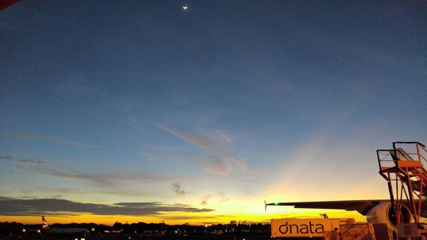 Syawal sunset with the crescent moon up top. Sky Outdoors Sunset Nature Beauty In Nature Airport Cloud - Sky Crescent Moon Syawal Working Hard LGV10 Lgv10photography Hustle