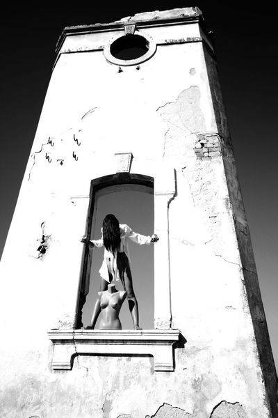 If I gain the courage to shout my dreams, would you laugh? Artistic Artistic Vision Black And White Conceptual Contrast Day Fantasy Fine Art Fine Art Photography Full Length Light And Shadow Low Angle View Moody One Person Outdoors People Sculpture Tower Vision White Dress Window Woman
