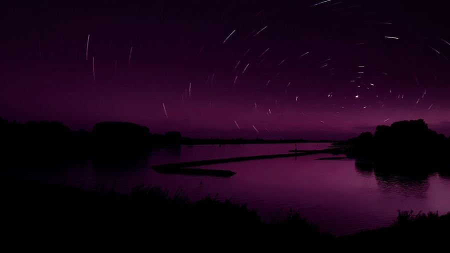 Purple Night Scenics Tranquil Scene Water Tranquility Silhouette Night Beauty In Nature Dark Nature Sky Majestic Outdoors Countryside Star Trail Sea Non-urban Scene Star Field No People Larayana My Favorite Place Planet Larayana