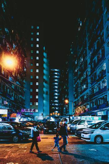 City street and illuminated buildings at night