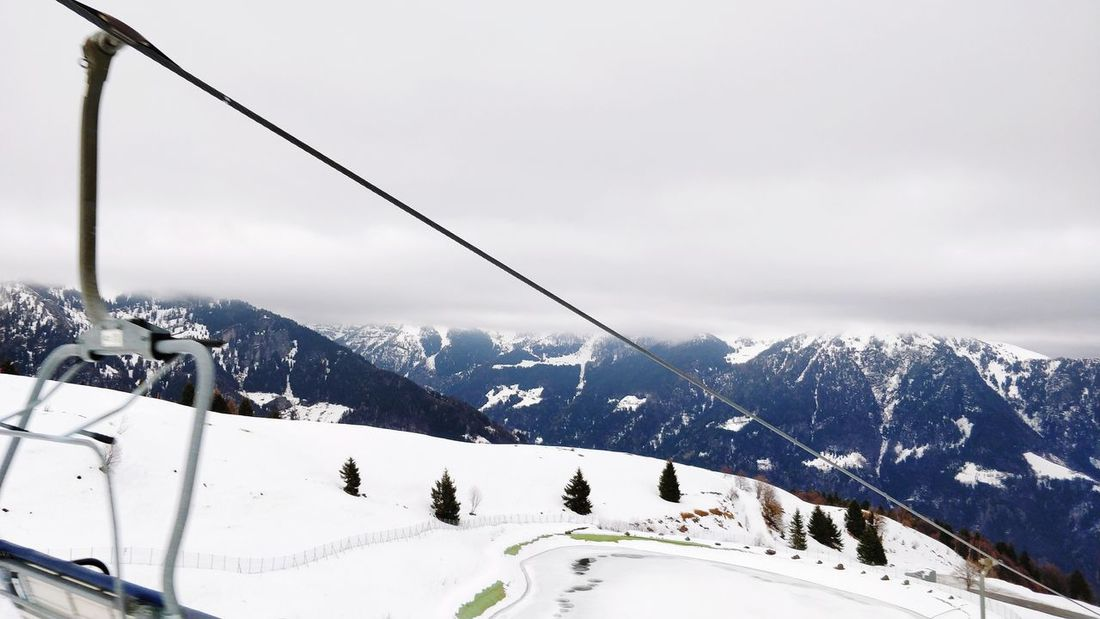 Between clouds and snow. EyeEm Selects Snow Winter Mountain Cold Temperature Winter Sport Ski Holiday Skiing Snowcapped Mountain Vacations Nature Overhead Cable Car No People Ski Lift