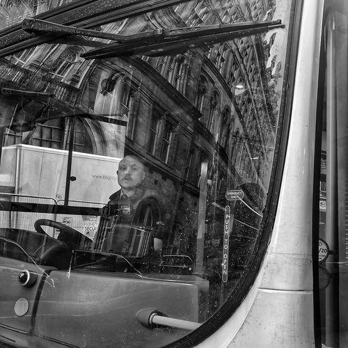 Portrait of man seen through glass window