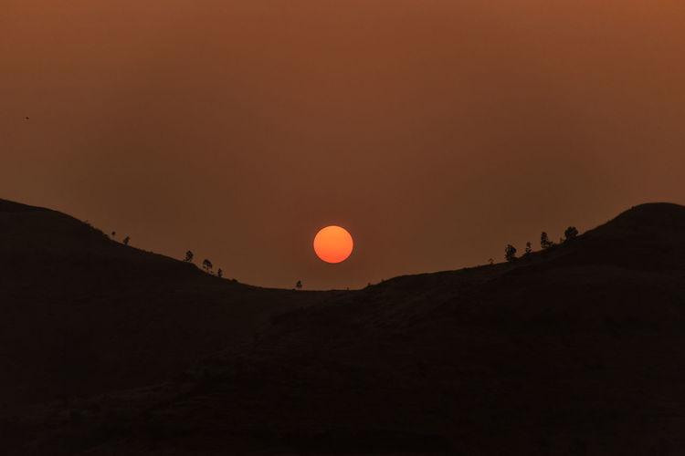 Sun Dusk Dawn Sunset Silhouettes Sillouette Astronomy Moon Sunset Orange Color Full Moon Sky Landscape Solar Eclipse Eclipse Arid Climate Astrology Moonlight Crescent