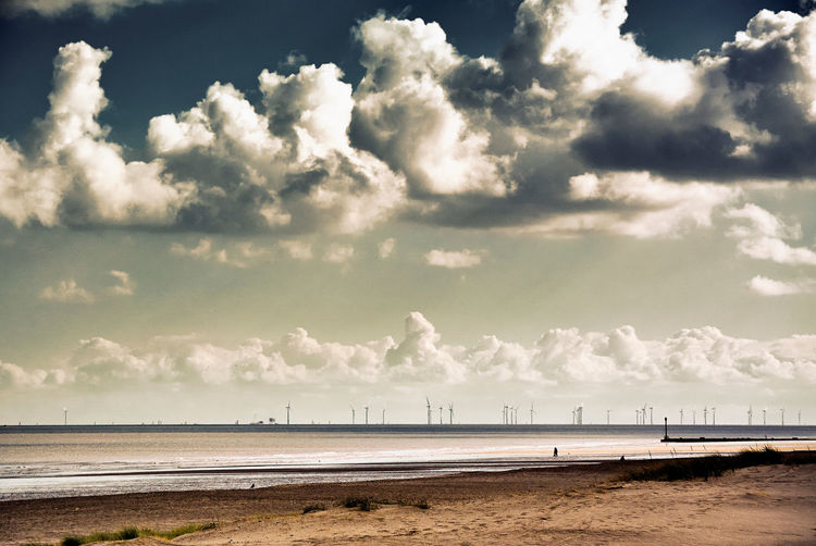 HORIZON: Sutton-on-Sea, Mablethorpe, Lincolnshire. Low Tide Wind Turbine Wind Farm Seascape Beach Beauty In Nature Cloud - Sky Day Horizon Horizon Over Water Idyllic Land Nature No People Outdoors Sand Scenics - Nature Sea Sky Tranquil Scene Tranquility Water Coast Shore Calm Coastal Feature