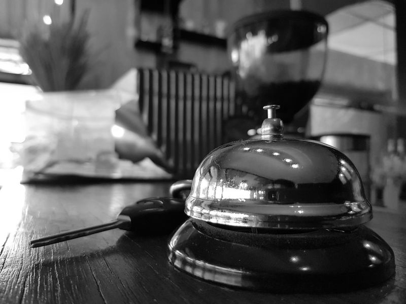 Ring bell at coffee shop Table Indoors  Close-up No People Day The Week On EyeEm EyeEmNewHere Coffee Shop Ring Bell Ringing Bell Bell Black And White Photography Black And White Black & White Key Classic Vintage Photo Vintage Manual Anolog Environment Shop