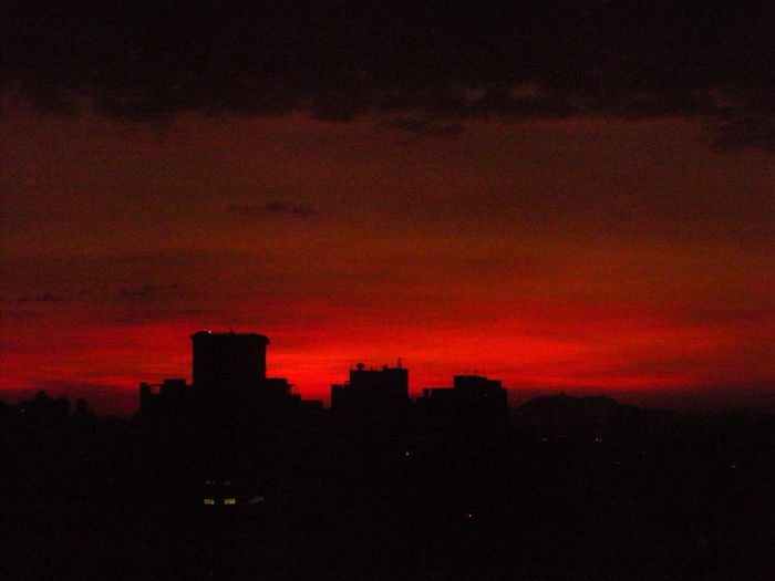 Unusually deep red-orange dramtic sunset July 1, 2018 over the City of São Paulo skyline looking towards the mountain Pico do Jaraguá. Romantic Skyline Skyline São Paulo Susan A. Case Sabir Unretouched Photography Beauty In Nature City Cloud - Sky Dramatic Sky Dramatic Sunset Dramatic Sunset Colors High Angle View Like Molten Lava In The Sky No People Orange Color Pretty Pretty Sunset Pretty Sunset View Red Color Romantic Sky Silhouette Skyline Sãopaulo Sunset Unusual Beauty