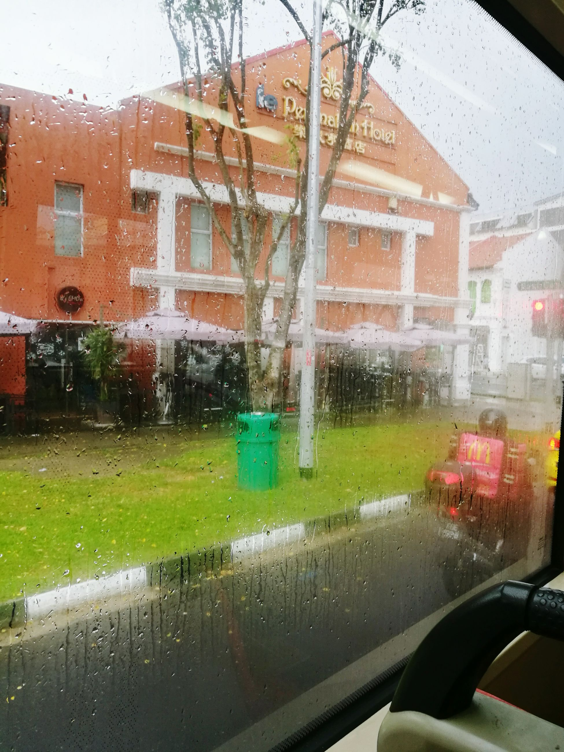 wet, glass - material, window, car, transportation, transparent, vehicle interior, land vehicle, mode of transport, weather, rain, water, drop, building exterior, rainy season, built structure, day, no people, architecture, sky, outdoors, close-up