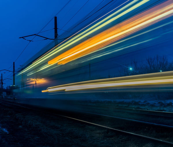 Train on railroad track at dusk