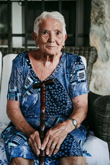 Close-up portrait of senior woman sitting