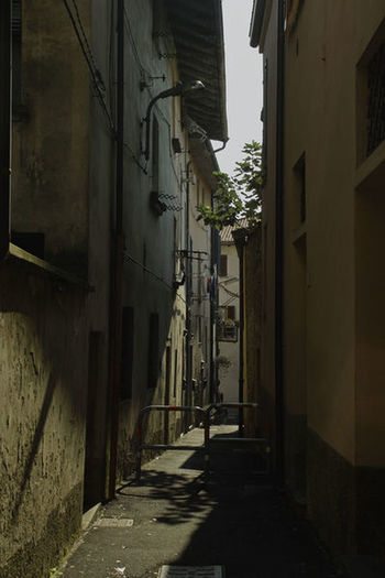Narrow street amidst buildings in city