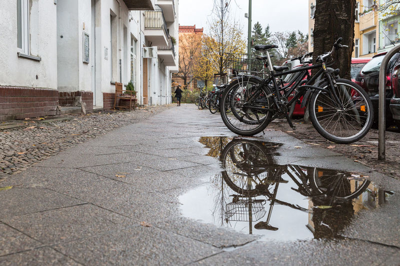 After Rain After The Rain Bicycle City Cityscape Cityscapes Mode Of Transport November Outdoors Overcast Parked Puddle Puddle Reflections Showcase: November Sidewalk Street Street Photography Streetphotography The Way Forward Water Reflections Wet Fall Leading Lines Learn & Shoot: Leading Lines