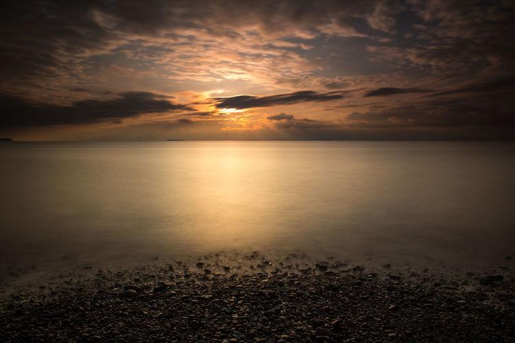 Dusk Sky Sand Bay Somerset England Beach Beauty In Nature Cloud - Sky Dramatic Sky Horizon Horizon Over Water Idyllic Land Nature No People Outdoors Reflection Romantic Sky Scenics - Nature Sea Seascape Sky Sun Sunset Tranquil Scene Tranquility Water
