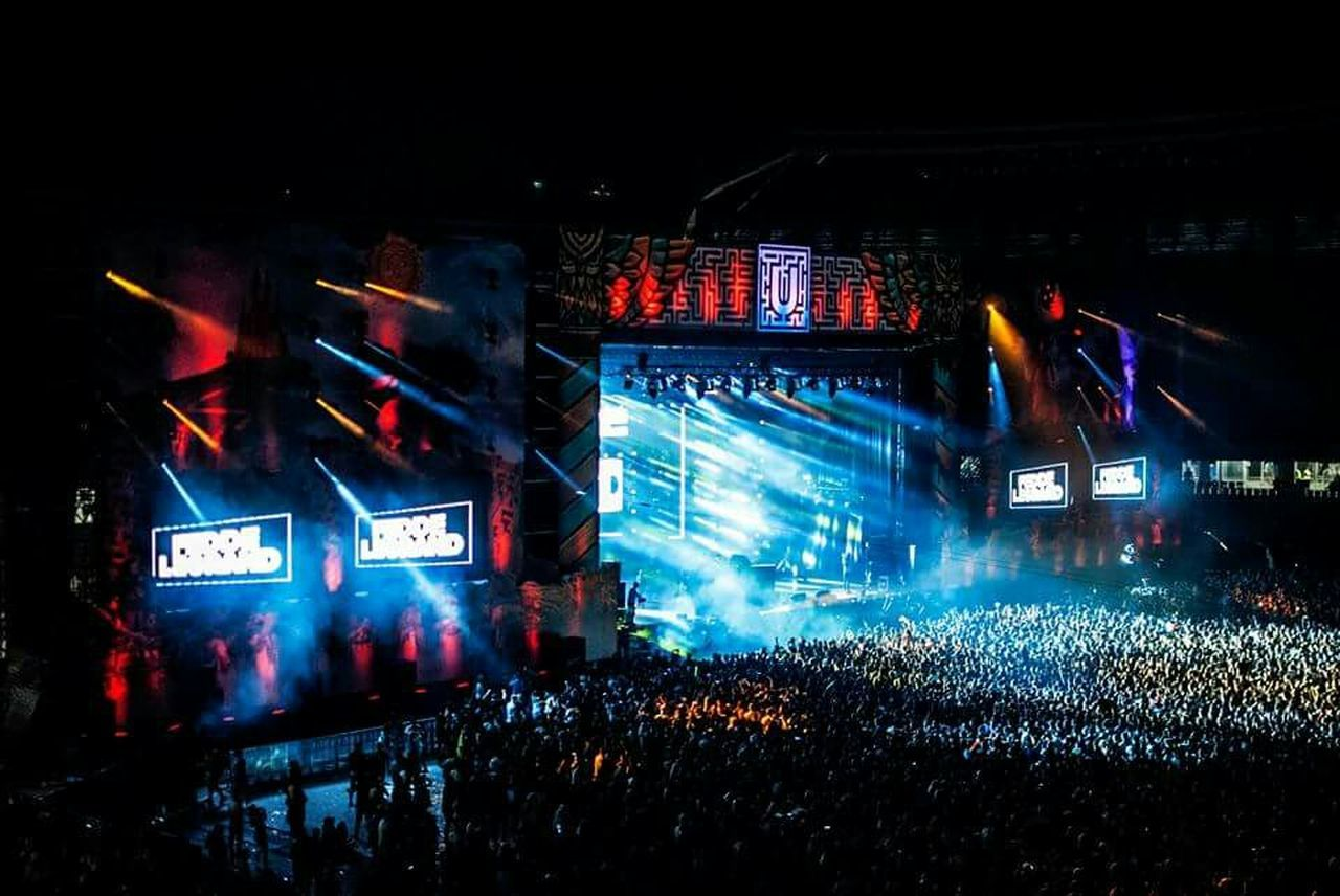 night, illuminated, crowd, nightlife, music, performance, large group of people, arts culture and entertainment, stage light, outdoors, audience, built structure, popular music concert, architecture, real people, people