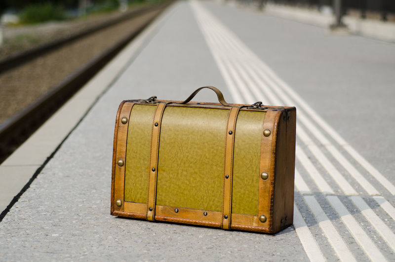 Old suitcase bag on the train station in Ticino, Switzerland. Antique Bag Color Communication Day Diminishing Perspective Focus On Foreground Luggage No People Old Outdoors Part Of Selective Focus Simplicity Suitcase Surface Level The Way Forward Tourism Train Station Train Station Platform Transportation Travel Vacations Vanishing Point Wood - Material