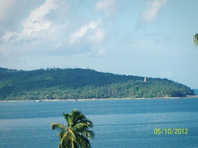 This is a very familiar location, a pic of the same island can be seen on a Rs.20 Indian note, captured from CellularJail, Andamanislands, India ,Sunny Day Nikon Lighthouse Sunny And Cloudy Island Port Blair Taking Photos Incredible India