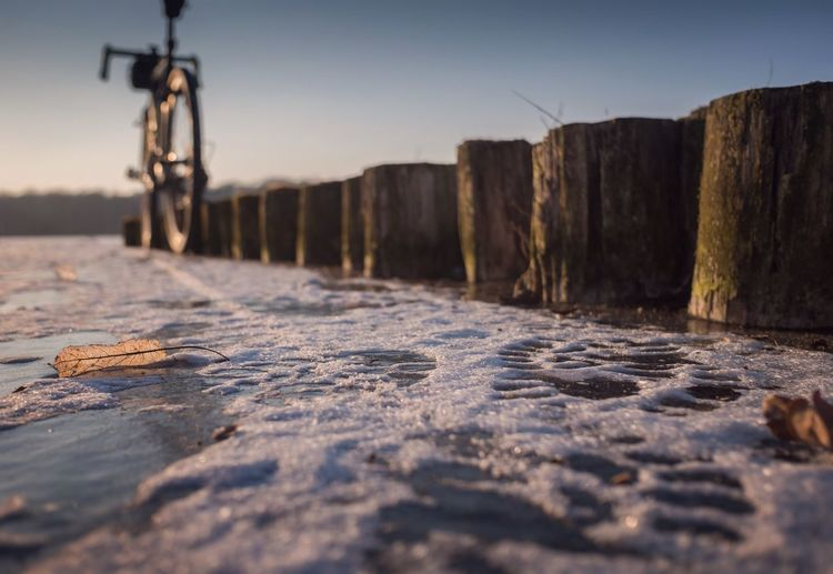Sunset Snow Bicycle Cycling Winter Ice Water Surface Level No People Nature Selective Focus Tranquility Sky Clear Sky Day Outdoors
