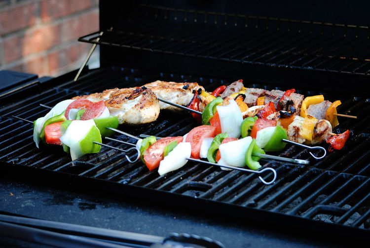 Close-up of food in skewers on barbecue grill