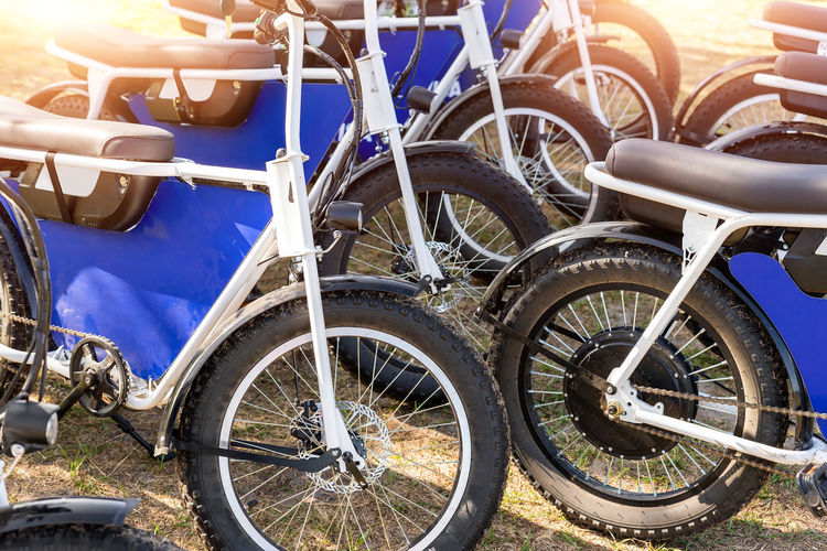 Close-up of bicycle parked on field