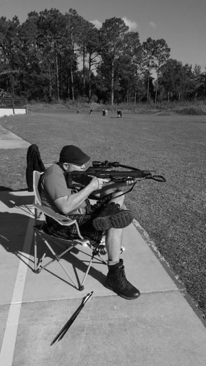 On the Range. Pensacola Florida Black And White Friday Perspectives On People Close-up Portrait Real People Men One Mature Man Only Sitting Archery Archery Range See The Light