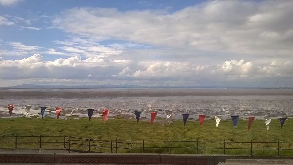 Red, White and Blue Bunting spanning the horizon and the view across Morecambe Bay from an apartment window on The Esplanade at Knott End on Sea, Lancashire UK Celebration Knott End On Sea Lancashire Morecambe Bay  Beach Beauty In Nature Bunting Cloud - Sky Day Flags Grass Horizon Over Water In A Row Nature No People Outdoors Sand Scenics Sea Sky Tranquil Scene Tranquility Water