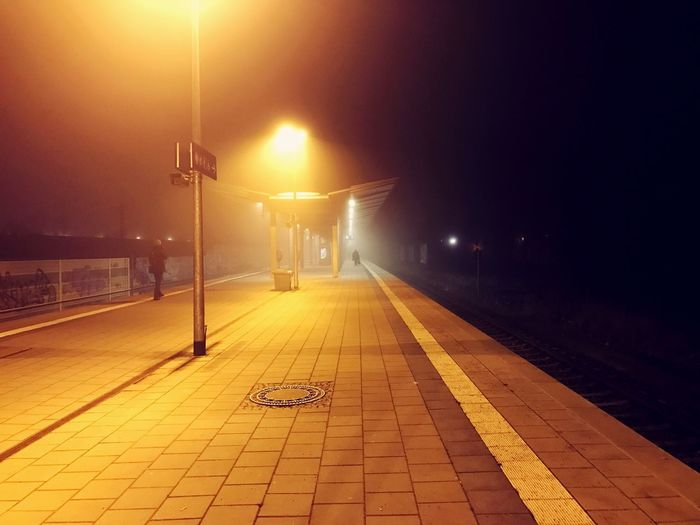 Foggy train station at night. Train Train Station Train Station Platform Fog Foggy Foggy Night Foggy Platform Athmospheric Spooky Illuminated Night Street Light Transportation No People Outdoors Sky Nature Architecture Munich Karlsfeld Sbahn