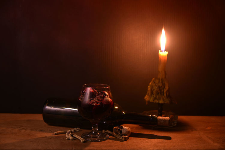 Black Background Burning Candle Close-up Copy Space Dark Electric Lamp Fire Fire - Natural Phenomenon Flame Glowing Heat - Temperature Illuminated Indoors  Lighting Equipment Melting Nature No People Single Object Still Life Table Wood - Material