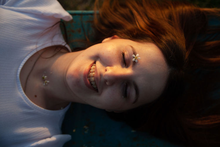 Portrait of young woman lying down