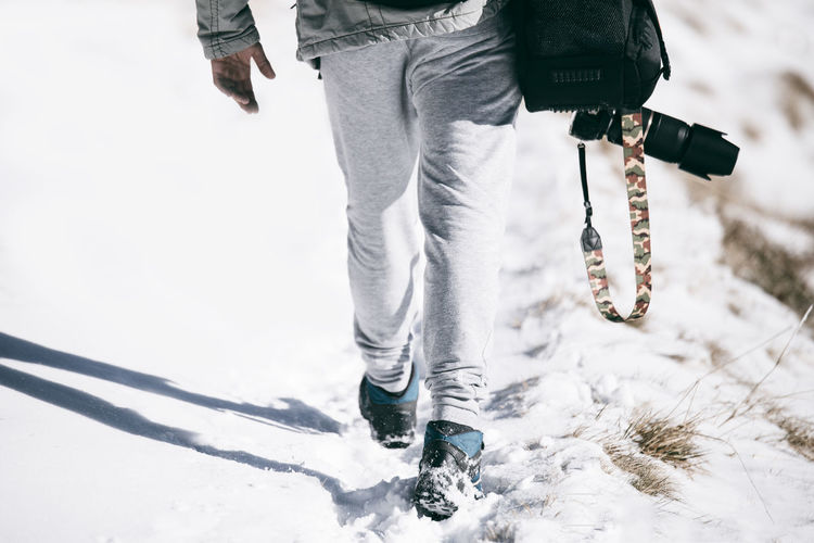 Away Bag Camera Camera - Photographic Equipment Camouflage Hiking Human Body Part Legs Lifestyles Low Section Men Menstyle One Man Only One Person People Photographer Shadow Shadows & Lights Snow Snow ❄ Traveler Walking Walking Around Winter Winter EyeEmNewHere