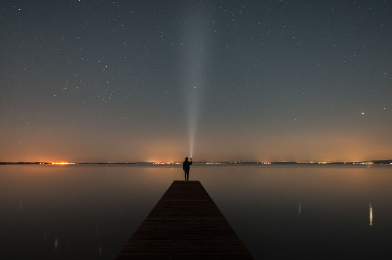 Reflection Pier Night Sky Beauty In Nature Tranquil Scene Clear Sky Landscape Star - Space Scenics Lake Nature Awe Water Astronomy Horizon Over Water One Man Only Illuminated Constellation Capture Tomorrow