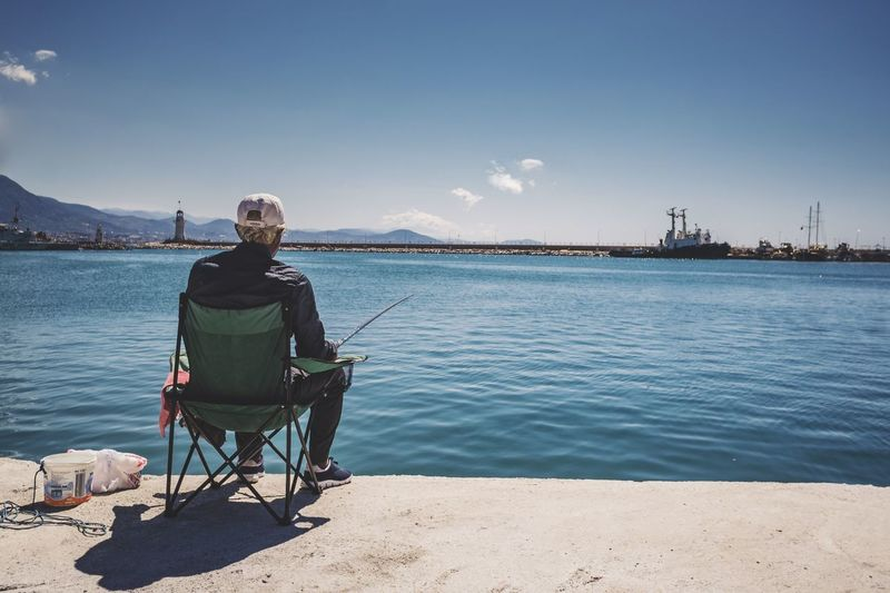 The fisherman Chair Sitting Man Man Ship Alanya Seaport Port Fishing Life Fishing Port Fishing Fisherman Water Sky Real People Nature One Person Day Lifestyles Leisure Activity Sea Sunlight Sitting Outdoors Casual Clothing Focus On The Story