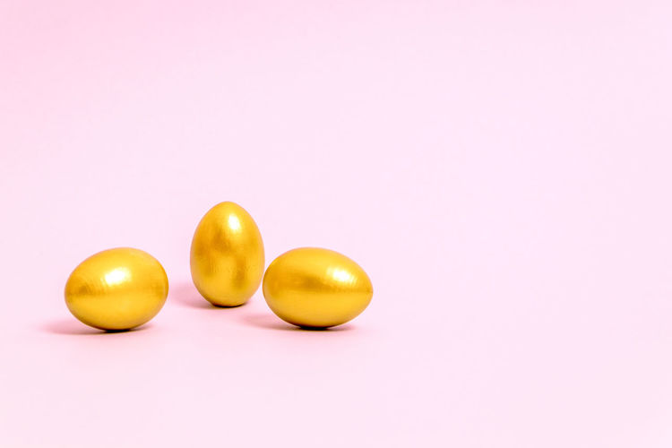 Close-up of yellow eggs against white background