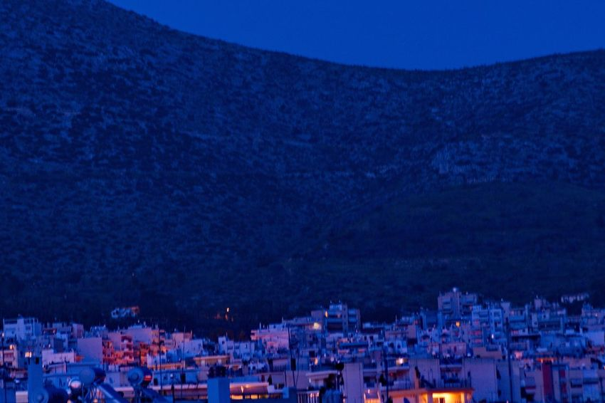 white buildings near a mountain in Athens Greece Outdoor Photography Europe Nightphotography Night Nature Athens, Greece Mountain Blue City Cityscape Crowd Popular Music Concert Star - Space Illuminated Mountain Blue Nightlife Sky TOWNSCAPE Town Residential Structure Old Town Residential District Human Settlement Housing Settlement