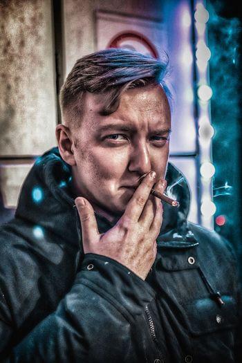 Portrait of man smoking cigarette