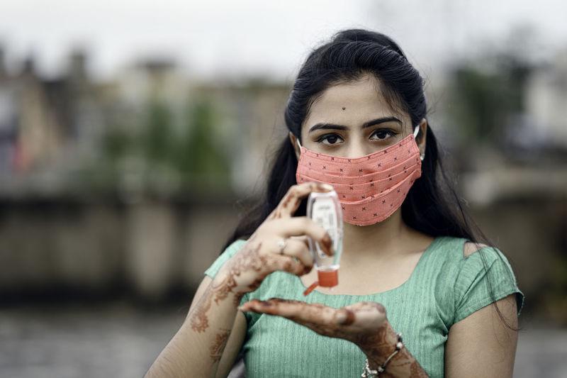 Portrait of woman holding camera