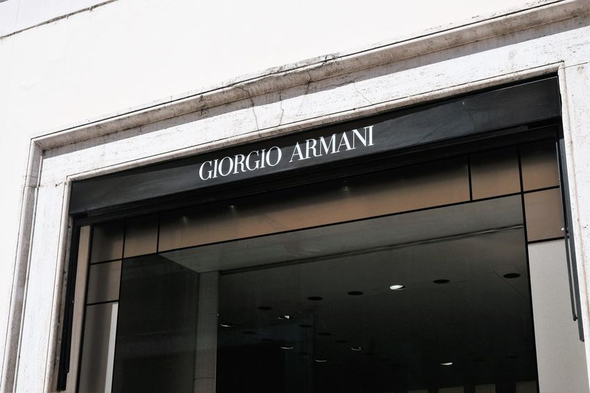 Rome, Italy - August 15, 2017: Giorgio Armani shop. It is an Italian fashion house which designs, manufactures, distributes and retails haute couture, ready-to-wear, leather goods, shoes, eyewear Armani Armani❤ Boutique Fashion Giorgio Armani Shopping Shopping Center Shopping ♡ Stylish Brand Editorial  Expensive Fashionable Giorgioarmani Italian No People Outdoors Outlet Shop Shopaholic Shopping Centre Shopping Mall Store Style Stylist
