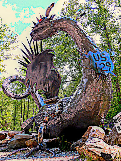 One of the T-Shirt stores ate the Tail of the Dragon has the most B.A. dragon made of motorcycly parts that are all welded together. It's totally rad! It's in this ltiile spot in North Carolina. Just follow the crowd of bikers. :) !! Art Beauty In Nature Buy The Ticket, Take The Ride Close-up Day Dragon Green Green Color Growth JustJennifer@TruthIsBeauty Metal Art Metal Sculpture Nature No People Outdoors Skulls Sky Tail Of The Dragon Tee Shirt Store Tranquility Tree TruthIsBeauty Photographic Art 🌷 TruthIsBeauty 💯 Us129 Welded Art