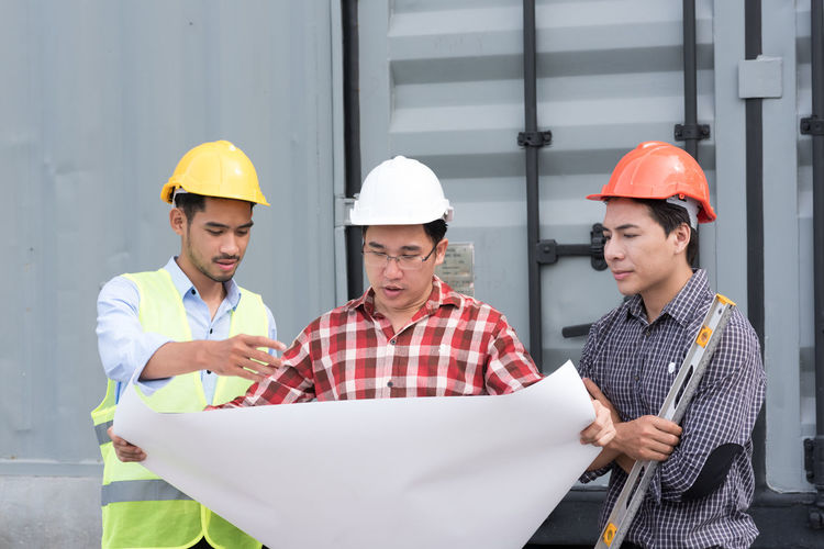 Architects Discussing Over Blueprint