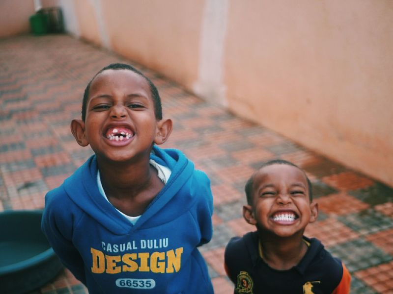 Eritrea Boys Brother Kids Kids Being Kids Fun Africa Smiling Child Cheerful Toothy Smile Portrait Happiness Outdoors Children Only Charity And Relief Work Real People Enjoyment Friendship Togetherness EyeEmNewHere