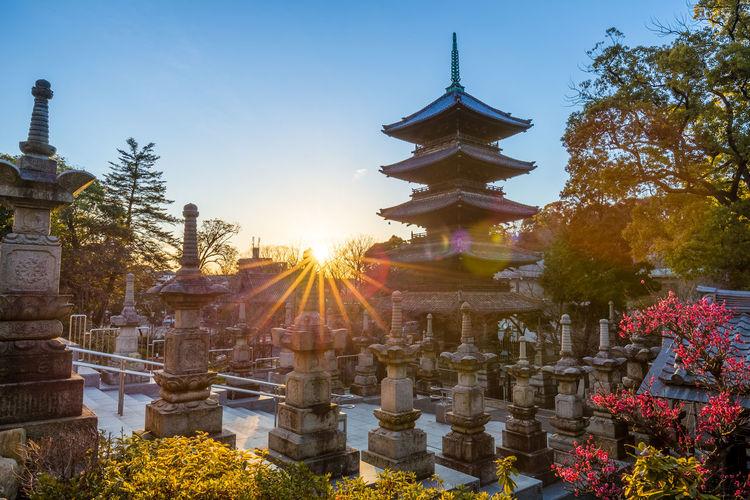 Back lit pagoda at kosho-ji temple against sky