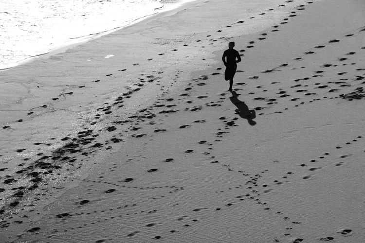 High angle view of woman running on beach