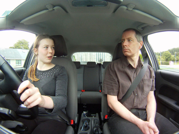 Portrait of a mid adult couple in car
