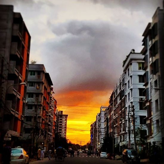 Beautiful sunset clicked while driving!! Sunset Lovers Beautiful Sky Awsome Sunset Awsomeview Beauty In Nature Beautiful View Nature_collection Landscape_collection EyeEmNatureLover Awsomeweather Sunset Dramatic Sky Cloud - Sky EyeEm Best Shots - Sunsets + Sunrise Built Structure Cityscape City Dhakacity Bangladesh 🇧🇩 Multi Colored The Week On EyeEm EyeEmNewHere