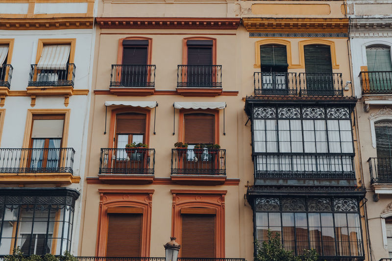 Traditional buildings on a street in seville, spain.